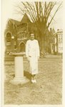 LU-083.0001 - Olive Iler standing on campus lawn. High Street in background