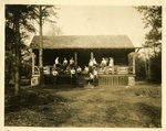 LU-083.0288 - Athletic Association/Delta Psi Kappa, posing on front porch of cabin