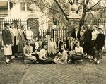 LU-083.0289 - Athletic Association (Olive Iler in center) posing in front of campus gates. Doyne-Burger Funeral Home in background.