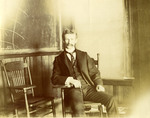 LU-083.1748 - Unknown man seated in chair in front of blackboard