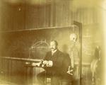LU-083.1750 - Man with moustache behind podium, next to skeleton