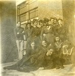 LU-083.1754 - Unknown group of men and women posing outside building. Circa early 1900s