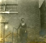 LU-083.1755 - Unknown woman standing outside. Circa early 1900s