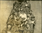 LU-083.1756 - Unknown group of men and women seated on doorstep. Circa early 1900s