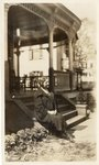054.025 - Unidentified woman sitting on steps of unidentified home. by Longwood University