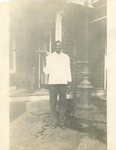 HS-022.032, Unidentified African-American man wearing white coat, holding a tray