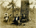 LU-157.0021 - John Chester Mattoon and students sitting underneath a tree by John Chester Mattoon