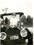 LU-157.0026 - Young girl on hood of Model T by John Chester Mattoon