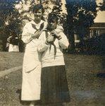 LU-182.007, two unidentified women standing on lawn.