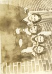 LU-182.012, four unidentified women standing outside campus building