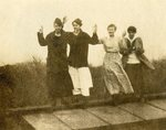 LU-182.016, four unidentified women standing on roof of building