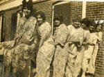 LU-182.018, seven unidentified women wearing robes