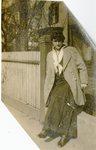LU-182.027, unidentified woman sitting on wall