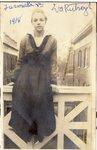 "LU-387.001, Woman seated on elevated breezeway railing. Inscribed on top margin, ""Farmville, Va., 1918. Eva Rutrough."" by Katherine Krebs"
