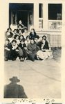 LU-387.007, Sixteen women seated on steps in front of Richardson Home (later known as Moss Home), corner of Buffalo & Randolph Streets. by Katherine Krebs
