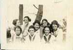 "LU-387.013, Group photo, eight women in front of tree. Inscribed, ""Burdett, K.K. (Katherine Krebs), Katherine, Eva, Salle, Florence, Nancy, Eliza W."" by Katherine Krebs"