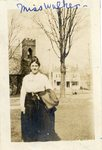 """LU-387.019, Woman standing on lawn in front of Rotunda. Episcopal Church and Richardson Home (later known as Moss Home) seen in background. Inscribed along top margin, """"Miss Walker."""" by Katherine Krebs"""