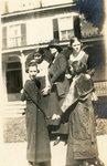 LU-387.025, Five unidentified women standing on sidewalk outside unidentified home. by Katherine Krebs