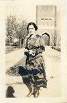 LU-387.033, Unidentified woman standing on sidewalk in front of Methodist Church by Katherine Krebs